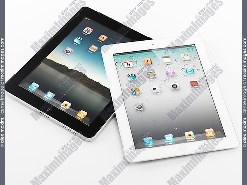 White Apple iPad 2 and black iPad tablet computers. Isolated on white background.