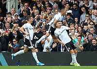 Fulham's Tom Cairney (right)  celebrates scoring the opening goal with Aleksandar Mitrovic<br /> <br /> Photographer David Shipman/CameraSport<br /> <br /> The EFL Sky Bet Championship - Fulham v Blackburn Rovers - Saturday 10th August 2019 - Craven Cottage - London<br /> <br /> World Copyright © 2019 CameraSport. All rights reserved. 43 Linden Ave. Countesthorpe. Leicester. England. LE8 5PG - Tel: +44 (0) 116 277 4147 - admin@camerasport.com - www.camerasport.com