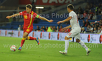 Aaron Ramsey of Wales puts in a cross to the Serbia goal area during the Wales v Serbia FIFA World Cup 2014 Qualifier match at Cardiff City Stadium, Cardiff, Wales -Tuesday 10th Sept 2014. All images are the copyright of Jeff Thomas Photography-07837 386244-www.jaypics.photoshelter.com