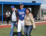 Western Nevada College's Spencer Greer escorts his family onto the field for Sophomore Day festivities at John L. Harvey field, on Sunday, April 27, 2014, in Carson City, Nev.<br /> Photo by Cathleen Allison/Nevada Photo Source