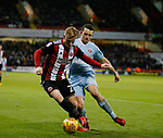 Mark Duffy of Sheffield Utd and George Honeyman of Sunderland during the Championship match at Bramall Lane Stadium, Sheffield. Picture date 26th December 2017. Picture credit should read: Simon Bellis/Sportimage