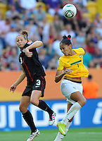 Christie Rampone (l) of team USA and Aline of team Brazil during the FIFA Women's World Cup at the FIFA Stadium in Dresden, Germany on July 10th, 2011.