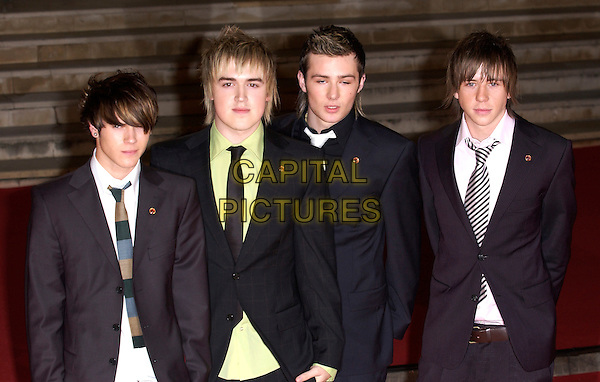 McFLY.DOUGIE PYNTER, TOM FLETCHER, HARRY JUDD & DANNY JONES.Red Carpet Arrivals at the Brit Awards 2005,.Earls Court 2, London, February 9th 2005..half length suits.Ref: FIN.www.capitalpictures.com.sales@capitalpictures.com.©Steve Finn/Capital Pictures .