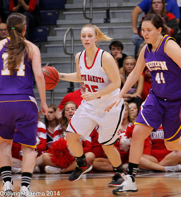 SIOUX FALLS, SD - MARCH 9:  Nicole Seekamp #35 of USD dribbles between Western Illinois defenders Michelle Maher #14 and Sophie Reichelt #44 during their quarterfinal game at the 2014 Summit League Basketball Championships at the Sioux Falls Arena Sunday. (Photo by Dick Carlson/Inertia)