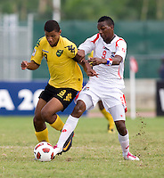 Omar Holness (9) of Jamaica fights for the ball with Omar Browne (9) of Panama during the third place game of the CONCACAF Men's Under 17 Championship at Catherine Hall Stadium in Montego Bay, Jamaica. Panama defeated Jamaica, 1-0.