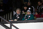 Two elderly women home supporters in the main stand waiting for the players to come on to the pitch at Victory Park, before Chorley played Altrincham in a Vanarama National League North fixture. Chorley were founded in 1883 and moved into their present ground in 1920. The match was won by the home team by 2-0, watched by an above-average attendance of 1127.