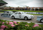 10th September 2017, Goodwood Estate, Chichester, England; Goodwood Revival Race Meeting; A pair of Jaguar mk1's race out of the Goodwood chicane
