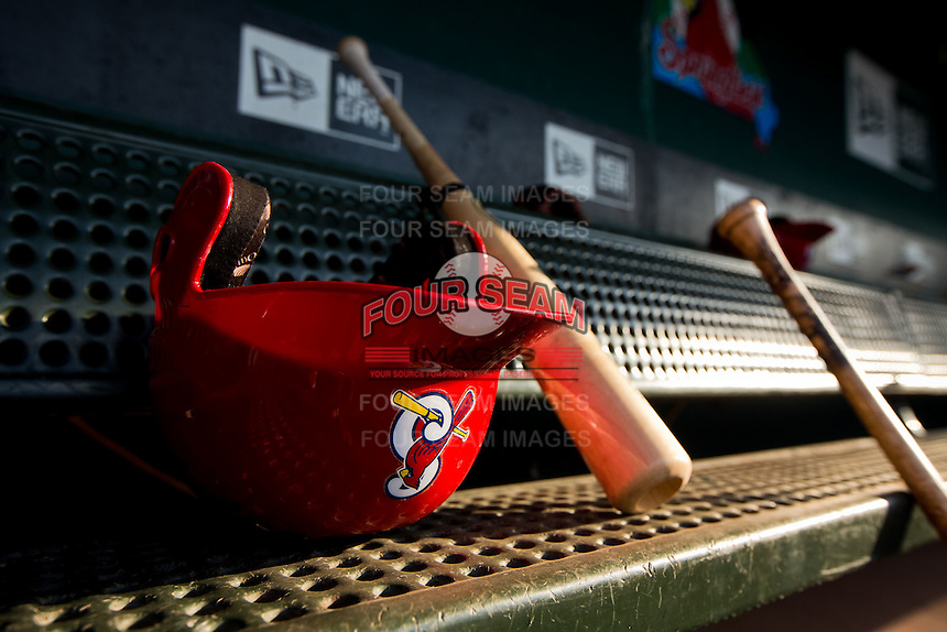 A helmet and bat of a Springfield Cardinals player sits in the dugout during a game between the Arkansas Travelers and the Springfield Cardinals at Hammons Field on July 24, 2012 in Springfield, Missouri. (David Welker/Four Seam Images)