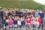 Patsy Cronin from the South Kerry Development Partnership cuts the tape to officially open the Sports courts in Rossbeigh beach on Sunday.
