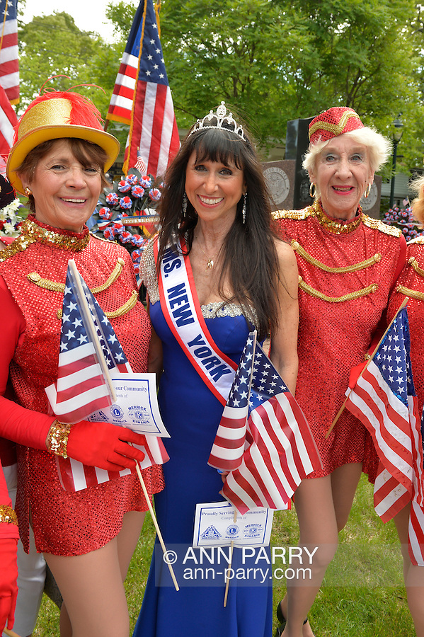 Merrick, New York, U.S. - May 26, 2014 - JANE RUBINSTEIN, Ms. New York Senior America, wears blue gown and tiara, and is flanked by senior dancers, in The Merrick Memorial Day Parade and Ceremony, hosted by American Legion Post 1282 of Merrick, honoring those who died in war while serving in the United States military. Rubenstein is from Merrick.