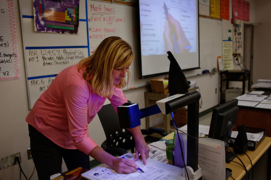 Lindsay, California, September 5, 2012 - Teacher Tammy Hellwig cover the complex grading structure for her Physical Science class at Lindsay High School. The school began building a competency-based education model about 7 years ago, fully implementing it just over three years ago and is set to graduate its first class this school year. This model does away with traditional grading and pass/fail for grades. Instead students are expected to achieve proficiency in a range of areas in each class, where a 3 (equal to a traditional B) is passing; A 4 is considered intensive and usually denotes college bound. Says Principal Jaime Robles, ?This allows students to learn at there own pace. If a student is advanced, they can move ahead, and if a student is lagging, they get the support they need.? Part of this model allows for students who are more advanced dig deeper and push harder and truly move ahead of others. Because they are ahead, some spend the extra time learning more, others take concurrent classes at the nearby community college and some choose to graduate early to start their path. ?Each student has their own set of goals,? says English teacher Amalia Lopez, ?Whatever their goals are, we support them.?..Slug: DD_ Competency.Byline: Daryl Peveto / LUCEO for Education Week