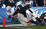 Air Force's Anthony LaCoste (37) dives into Nevada's end zone during the first half of an NCAA football game in Reno, Nev., on Saturday, Sept. 28, 2013. (AP Photo/Cathleen Allison)
