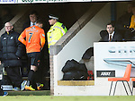 St Johnstone v Dundee United.....29.12.13   SPFL<br /> David Goodwillie goes straight up the tunnel after being subbed in the first half as manager Jackie McNamara sits in the dugout<br /> Picture by Graeme Hart.<br /> Copyright Perthshire Picture Agency<br /> Tel: 01738 623350  Mobile: 07990 594431