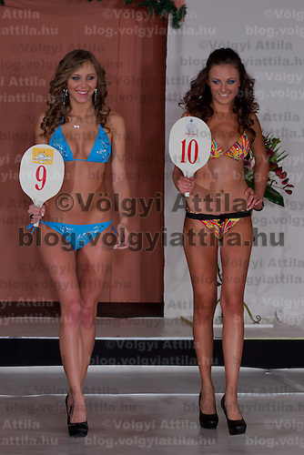 Agnes Makai (L) and Edina Szommer (R) participate the Miss Hungary beauty contest held in Budapest, Hungary on December 29, 2011. ATTILA VOLGYI
