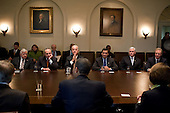 Washington, DC - December 9, 2009 -- United States Vice President Joe Biden and members of Congress listen as U.S. President Barack Obama speaks during a bipartisan Congressional leadership meeting in the Cabinet Room of the White House, Wednesday, December 9, 2009.  From left to right: U.S. Senator Mike Enzi (Republican of Wyoming); U.S. Senator Chuck Schumer (Democrat of New York); Vice President Biden; unidentified,unidentified, U.S. Representative Chris Van Hollen (Democrat of Maryland).Mandatory Credit: Pete Souza - White House via CNP