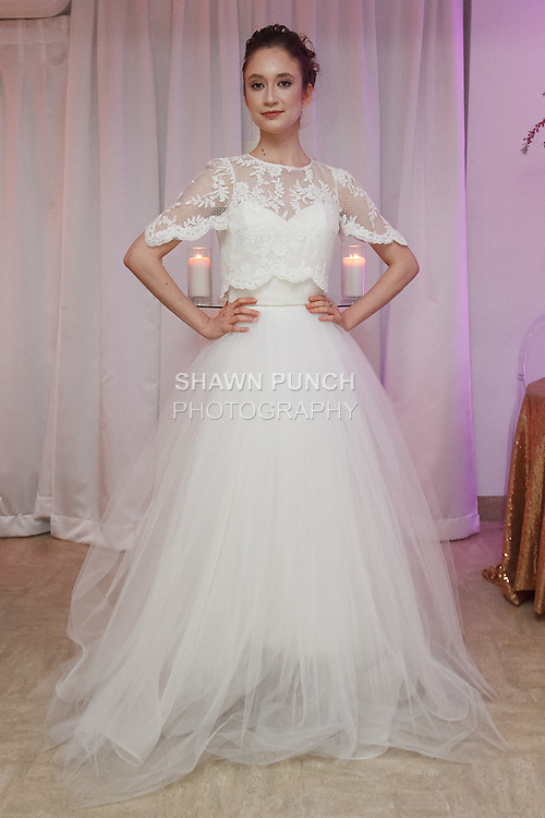 Model poses in a wedding dress from the Pas de Deux Bridal collection at the With This Ring event, host by Menagerie and Punto Space, at 325 West 38th street in New York City, during New York Bridal Fashion Week Spring Summer 2017.