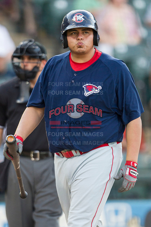 Oklahoma City RedHawks designated hitter Japhet Amador (48) walks away after striking out against the Round Rock Express during the Pacific Coast League baseball game on August 25, 2013 at the Dell Diamond in Round Rock, Texas. Round Rock defeated Oklahoma City 9-2. (Andrew Woolley/Four Seam Images)