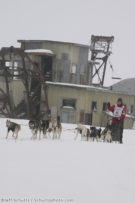 Aily Zirkle passes Swanberg's gold dredge on the trail nearing Nome in foggy conditions.     End of the  2005 Iditarod Trail Sled Dog Race.