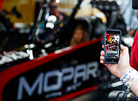 Feb 10, 2018; Pomona, CA, USA; Detailed view as an iPhone is used to film NHRA top fuel driver Leah Pritchett on video as she warms up her car during qualifying for the Winternationals at Auto Club Raceway at Pomona. Mandatory Credit: Mark J. Rebilas-USA TODAY Sports