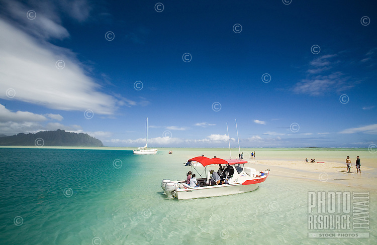 People relaxing on a motor boat at the Kaneohe Sandbar
