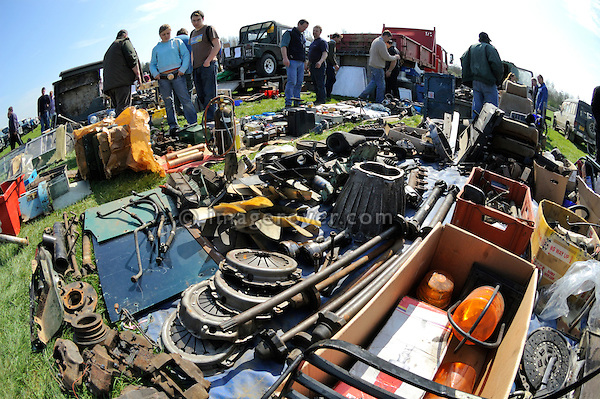 Land Rover enthusiasts selling rare second hand spare parts. Old Sodbury Land Rover Sortout on April 2 at Newbury Showground UK 2005. The Old Sodbury Sortout is the biggest autojumble for buying and selling Land Rover parts.