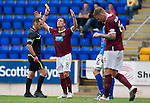 St Johnstone v Hearts...25.09.11   SPL Week 9.Ian Black shows his frustration as he his booked by Stevie O'Reilly.Picture by Graeme Hart..Copyright Perthshire Picture Agency.Tel: 01738 623350  Mobile: 07990 594431