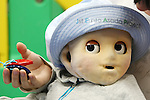 June 15, 2010 - Tokyo, Japan - A Japanese post-graduate student plays with a robot baby called Noby similar to a nine-month-old human at a laboratory at the Tokyo University, Japan, on June 15, 2010. The robot is 71 centimetres (28 inches) tall and weighs 7.9 kilogrammes (17 pounds), has two cameras and two microphones on its head and is also equipped with some 600 touch sensors in the artificial skin of his body. Noby is designed to simulate the behaviour and development of a real infant in an effort to better understand how humans grow up.
