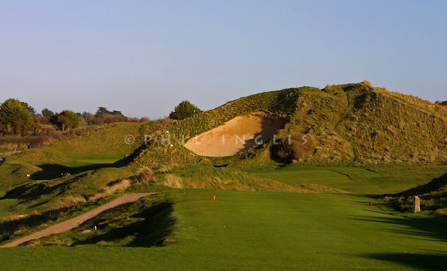 A giant bunker guards the entrance to the 6th green at St Enodoc Golf Club, Rock, Cornwall. Designed by James Braid. Picture Credit / Phil Inglis