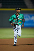 Down East Wood Ducks center fielder Julio Pablo Martinez (23) jogs off the field between innings of the game against the Winston-Salem Dash at BB&T Ballpark on May 10, 2019 in Winston-Salem, North Carolina. The Wood Ducks defeated the Dash 9-2. (Brian Westerholt/Four Seam Images)