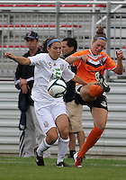 BOYDS, MARYLAND - July 21, 2012:  Amanda Naeher (4) of Charlotte Lady Eagles kicks the ball away from Gabrielle Charno (15) of the Long Island Roughriders during a W League Eastern Conference Championship semi final match at Maryland Soccerplex, in Boyds, Maryland on July 21.