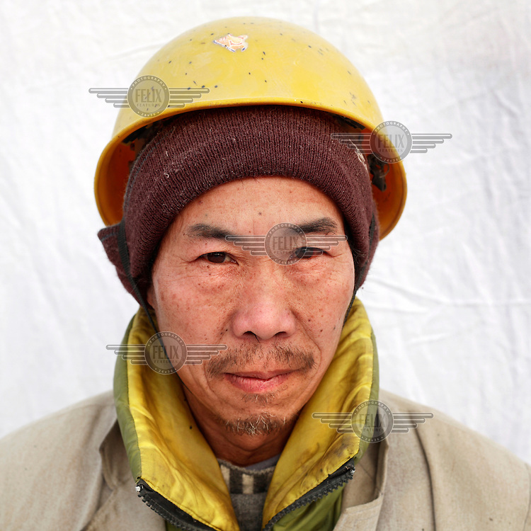 Li Deng Peng is a farmer from Sichuan Province. In Beijing he is a labourer earning 500 RMB ($67) a month. Migrant workers have come from all over China to Beijing to assist in the economic and construction boom in the run-up to the 2008 Olympic Games...