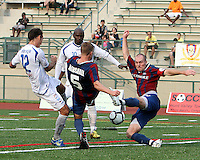 Shaun Pejic #4 and Andrew Marshall #5 of Crystal Palace Baltimore battle for the ball with Eduardo Sebrano #12 and Ali Gerba #10 of the Montreal Impact during an NASL match at Paul Angelo Russo Stadium in Towson, Maryland on August 21 2010. Montreal won 5-0.
