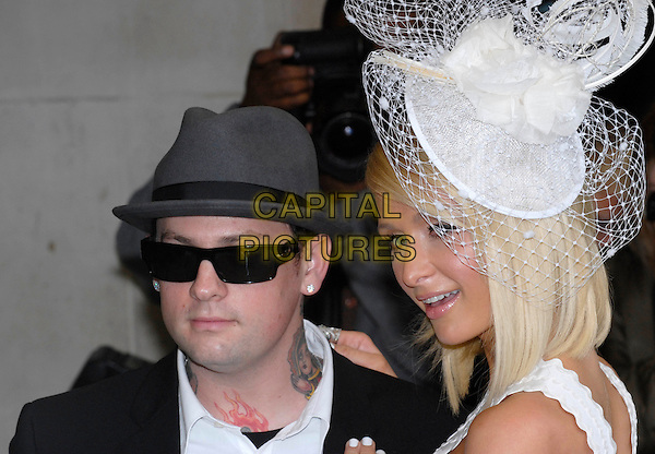 "BENJI MADDEN & PARIS HILTON.At the launch of Paris Hilton's new fragrance ""Can Can"", Selfridges, London, England, UK,.Ma 15th 2008..perfume white hat grey netting sunglasses couple boyfriend feathers tattoos portrait headshot.CAP/IA.©Ian Allis/Capital Pictures"