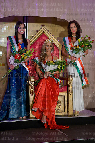 Queen Anett Maximovits (center), Dorottya Farsang (left) and Nora Keseru (right), winners of the Miss Hungary beauty contest pose during the final of the beauty pegant held in Budapest, Hungary. Saturday, 19. December 2009. ATTILA VOLGYI