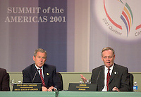 April 22,  2001, Quebecl, Quebec, Canada<br /> <br /> George W, Bush, United States of Americas President (R)  listen while <br /> Jean Chretien, Canada's Prime Minister (L) speak at the closing press conference of the Summit of the Americas , April 22, 2001 in Quebec City, CANADA.<br /> <br /> Both leader agreed to meet before the upcoming G-8 meeting this spring in Alberta, Canada.<br /> <br /> Mandatory Credit: Photo by Pierre Roussel- Images Distribution. (©) Copyright 2001 by Pierre Roussel <br /> ON SPEC<br /> NOTE l Nikon D-1 jpeg opened with Qimage icc profile, saved in Adobe 1998 RGB.