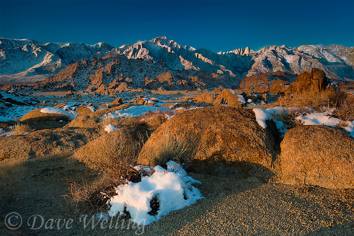 711700281 winter sunrise with snow covered granite boulders in the bureau of land management protected land the alabama hills in the southern section of the eastern sierras with lone pine peak mount whitney and mount russell in the background in kern county california