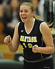 Wantagh No. 16 Nicole Hilton reacts as she and her teammates close in on victory over Long Beach in the Nassau County varsity girls' volleyball Class A final at SUNY Old Westbury on Wednesday, Nov. 11, 2015. Wantagh won 3-0.<br /> <br /> James Escher