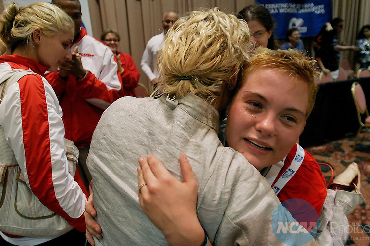 17 MARCH 2006: Erzsebet Garay, right, of St Johns is hugged by a teammate after she defeated Jacqueline Leahy of Princeton in the Foil division during the Division I Women's Fencing Championship held at the J.W. Marriott in Houston, TX.  Garay's victory gave her the national title. Dave Einsel/NCAA Photos