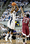 March 1, 2012: Nevada Wolf Pack gaurd Malik Story shoots over New Mexico State Aggies guard Daniel Mullings during their NCAA basketball game played at Lawlor Events Center on Thursday night in Reno, Nevada.