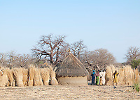 A family of the Nuba tribe outside their mud hut house in the village of Nyaro, Kordofan region, Sudan