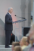 Arlington, VA - September 11, 2008 -- Deputy Secretary of Defense Gordon R. England delivers the opening remarks at the Pentagon Memorial dedication ceremony Sept. 11, 2008. The national memorial is the first to be dedicated to those killed at the Pentagon on Sept. 11, 2001. The site contains 184 inscribed memorial units honoring the 59 people aboard American Airlines Flight 77 and the 125 in the building who lost their lives that day.  .Credit: Cherie Cullen - DoD via CNP