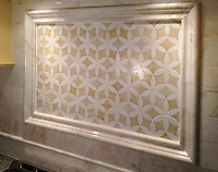 Fiona, a jewel glass waterjet mosaic shown in Quartz and Amber with Cloud Nine polished pencil and chair rails, 3&quot;x6&quot; Cloud Nine bricks, and 3 1/2&quot; waterjet Julius border shown in honed Cloud Nine and polished Paperwhite.<br />