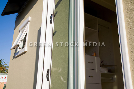 A house with dual paned glass (window and door) and James Hardie fiber cement siding which help to insulate the building, maximizing energy efficiency. This home is Santa Clara University's team entry in Solar Decathlon 2007 (scusolar.org). Santa Clara, California, USA
