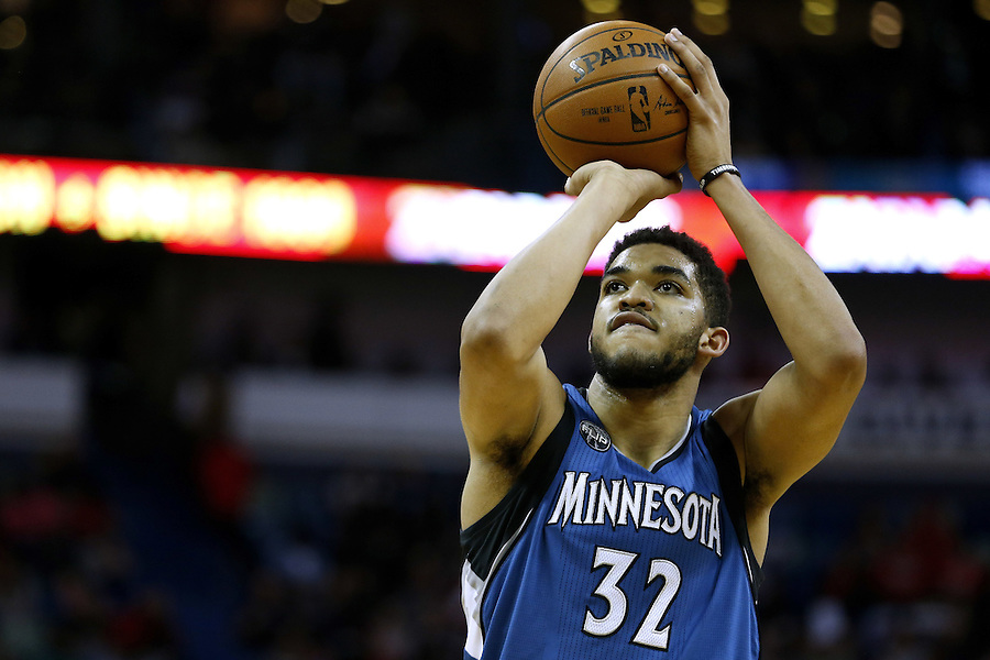 Minnesota Timberwolves center Karl-Anthony Towns (32) shoots the ball during the second half of an NBA basketball game Saturday, Feb. 27, 2016, in New Orleans. The Timberwolves won 112-110. (AP Photo/Jonathan Bachman)