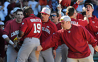 USC center fielder Jackie Bradley Jr. (19) is congratulated after hitting a home run during a game between the Clemson Tigers and South Carolina Gamecocks Saturday, March 6, 2010, at Fluor Field at the West End in Greenville, S.C. Photo by: Tom Priddy/Four Seam Images