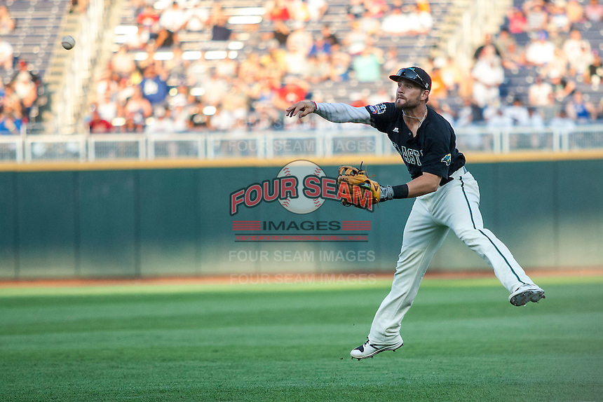 Coastal Carolina Chanticleers second baseman Tyler Chadwick (8) makes a running throw to first base against the Florida Gators in Game 4 of the NCAA College World Series on June 19, 2016 at TD Ameritrade Park in Omaha, Nebraska. Coastal Carolina defeated Florida 2-1. (Andrew Woolley/Four Seam Images)