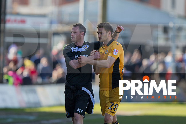 Newport County manager Mike Flynn celebrates with Mickey Demetriou at full time of the Sky Bet League 2 match between Newport County and Accrington Stanley at Rodney Parade, Newport, Wales on 22 April 2017. Photo by Mark  Hawkins.