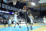 03 February 2013: Duke's Haley Peters (33) shoots over North Carolina's Megan Buckland (3). The University of North Carolina Tar Heels played the Duke University Blue Devils at Carmichael Arena in Chapel Hill, North Carolina in an NCAA Division I Women's Basketball game. Duke won the game 84-63.
