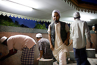During the holy month of ramadan in the backyard of the central mosque of Pattani, men are performing the ritual cleansing before their evening prayer. Thailand is struggling to keep up appearances as the land of smiles has to face up to its troubled south. Since 2004 more than 3500 people have been killed and 4000 wounded in a war we never hear about. In the early hours of January 4th 2004 more than 50 armed men stormed a army weapons depot in Narathiwat taking assault rifles, machine guns, rocket launchers, pistols, rocket-propelled grenades and other ammunition. Arsonists simultaneously attacked 20 schools and three police posts elsewhere in Narathiwat. The raid marked the start of the deadliest period of armed conflict in the century-long insurgency. Despite some 30,000 Thai troops being deployed in the region, the shootings, grenade attacks and car bombings happen almost daily, with 90 per cent of those killed being civilians. 19.09.07. Photo: Christopher Olssøn