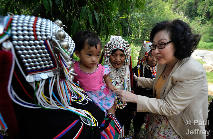 Cindy Moon (right), a United Methodist missionary in Thailand, greets traditionally dressed women with a child in Buyer, a small village in northern Thailand populated by indigenous hill tribe people. The women are members of the local United Methodist congregation.